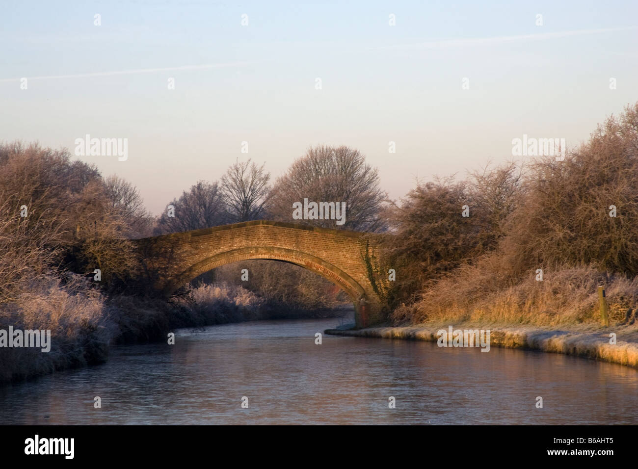 Canal and bridge in winter, Lymm, Warrington, Cheshire England - Stock Image