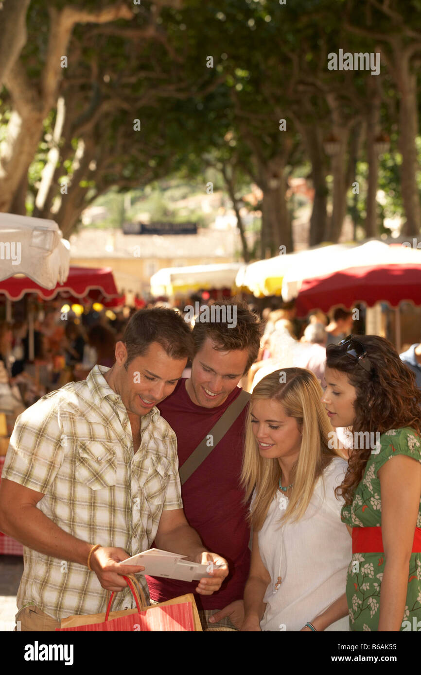 Friends shopping in french market - Stock Image