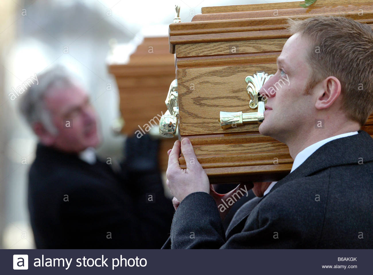 The double funeral of a mans daughter and his wife who were both killed in a road traffic accident - Stock Image