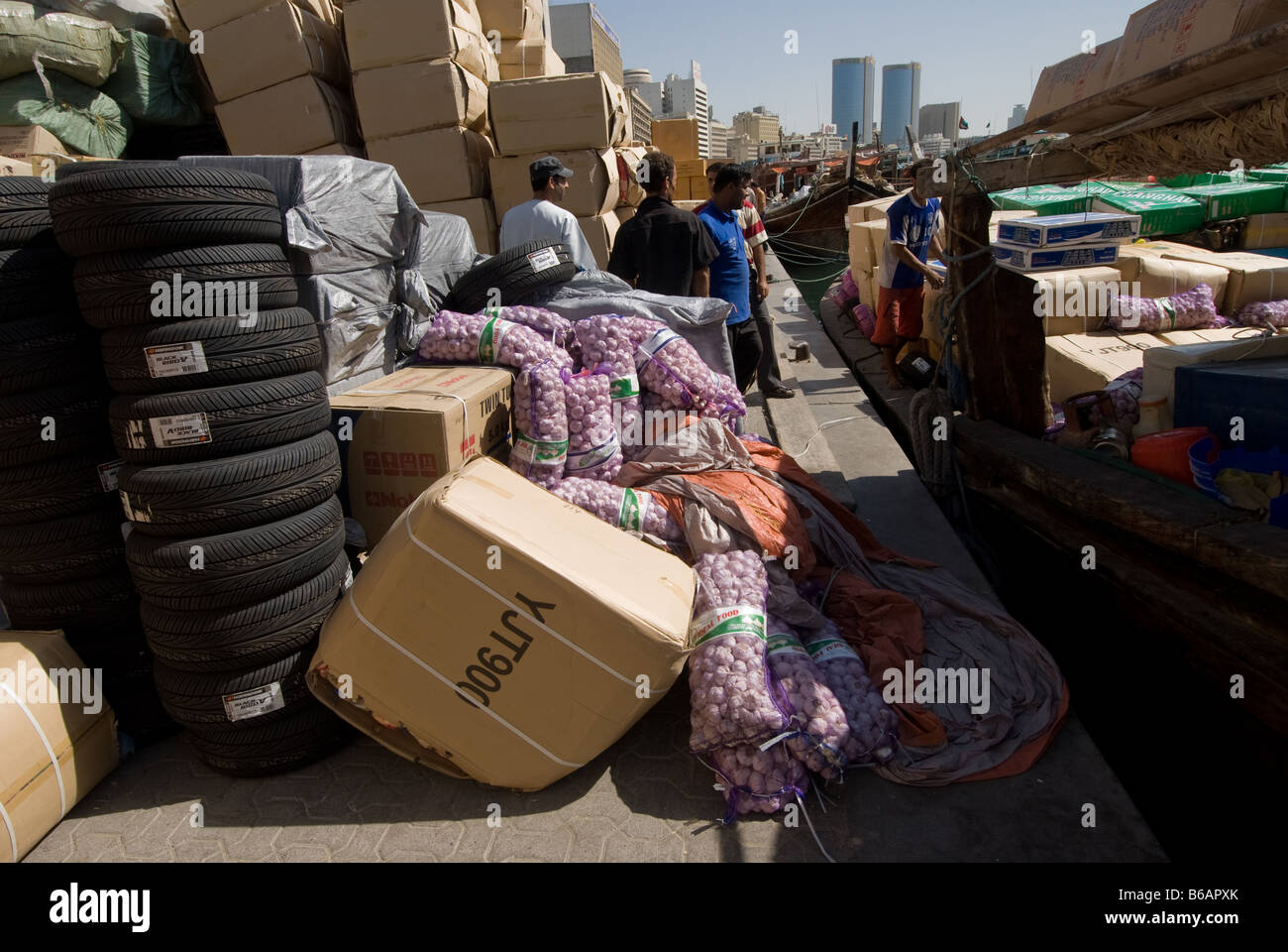 A wide variety of goods await loading on a small ship in Dubai creek