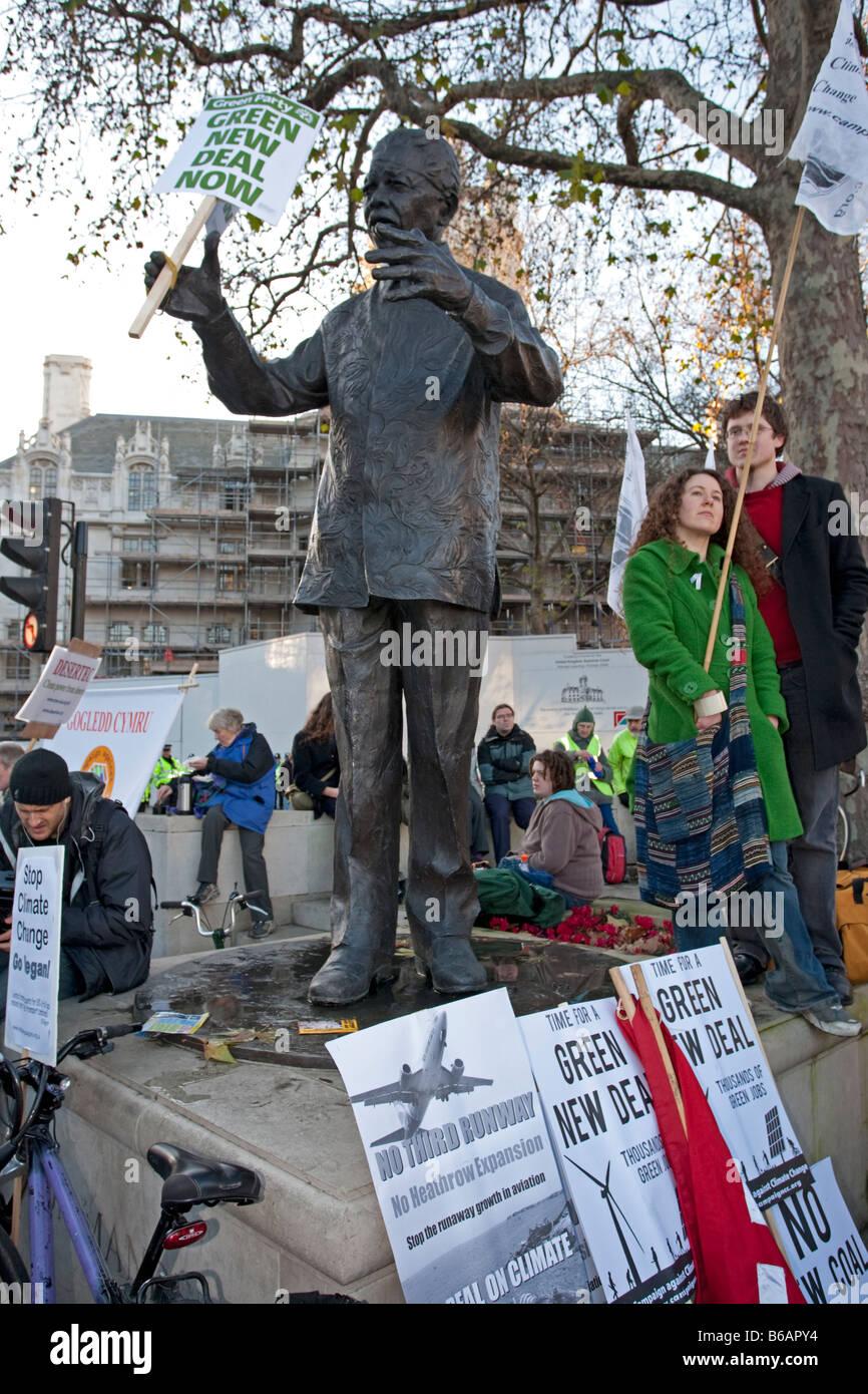 Statue Nelson Mandela holding new green deal banner Climate Change March London December 2008 UK Stock Photo