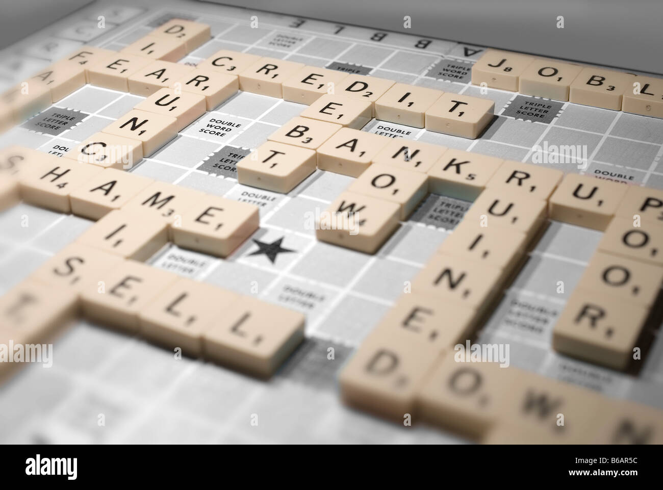 A scrabble game highlights global recession issues of the credit crunch and other financial implications - Stock Image