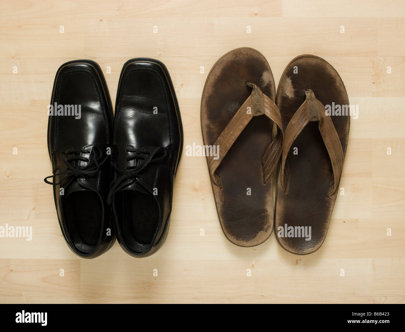 business shoes and flip flops - Stock Image