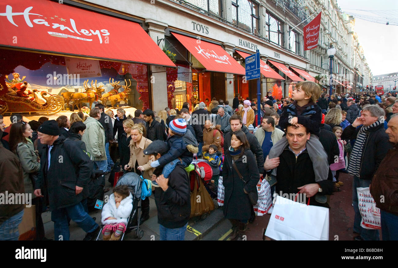Christmas shopping at Hamleys Toy Store in Regent Street in London - Stock Image