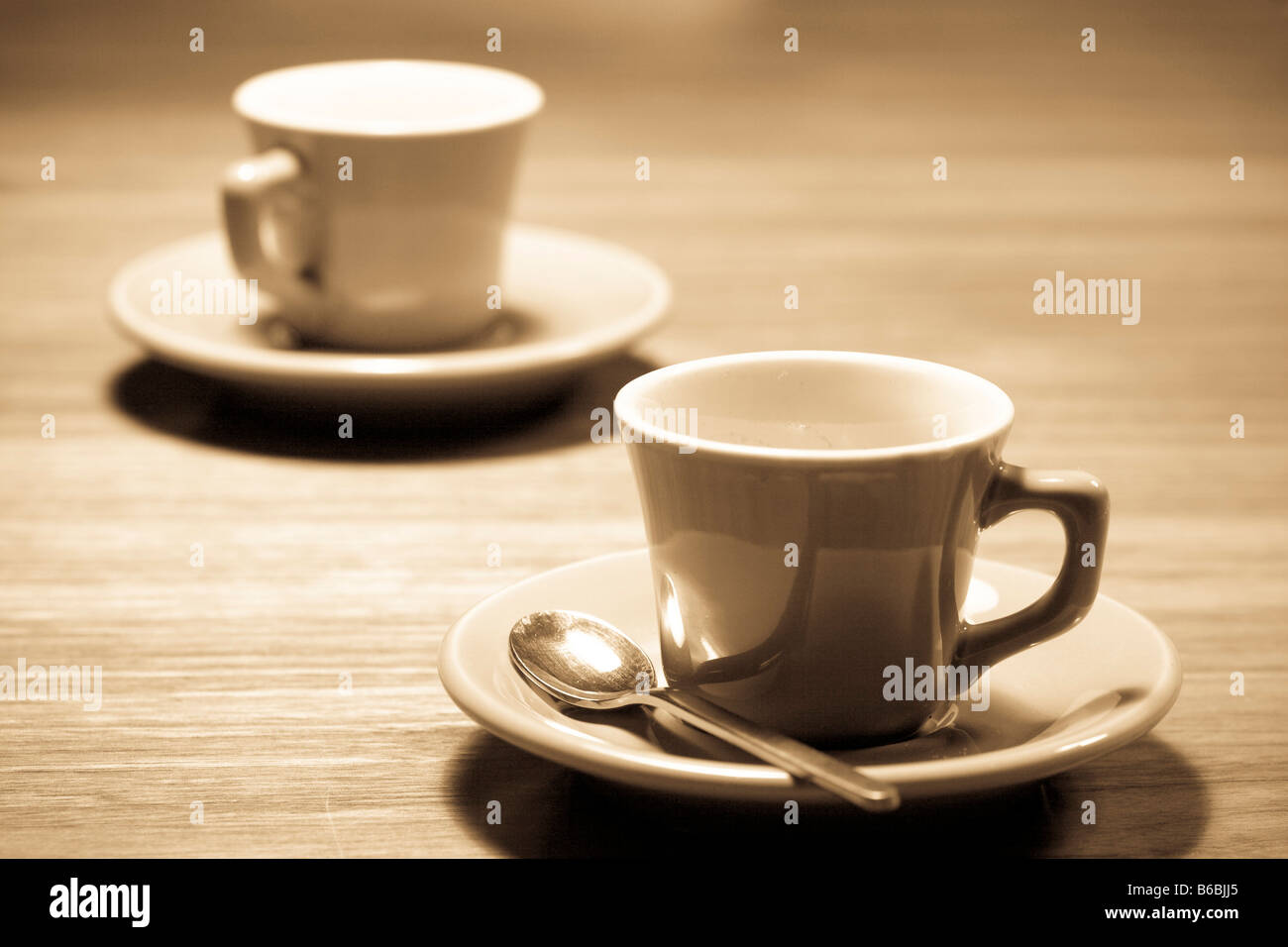 Two teacups on saucers - Stock Image