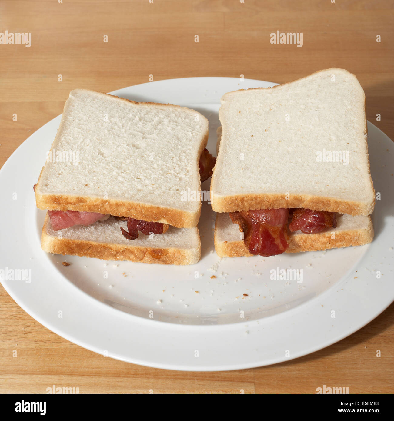 Bacon butty in white bread - Stock Image