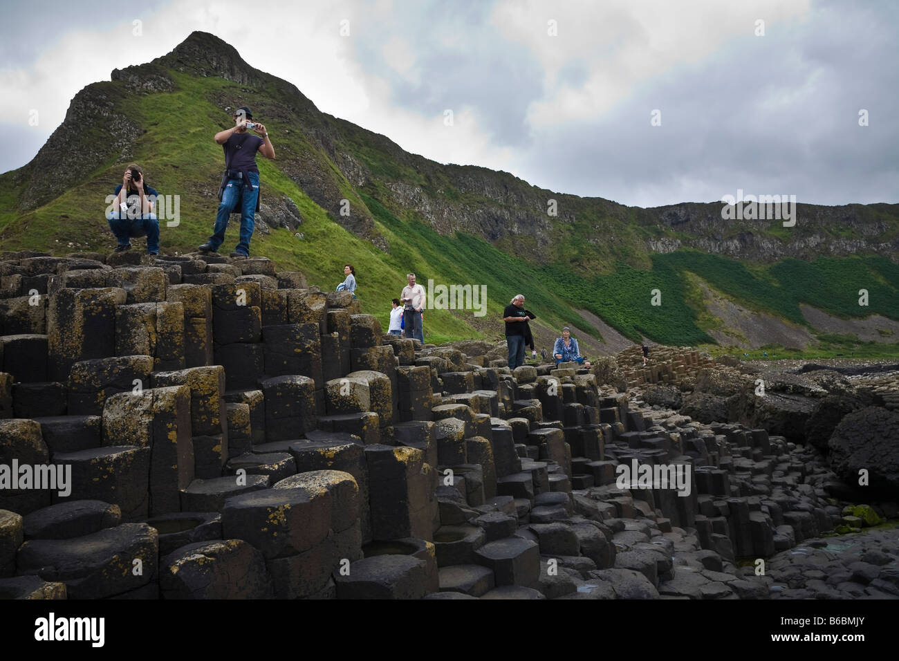 Tourists at the Giant's Causeway, County Antrim, Northern Ireland Stock Photo