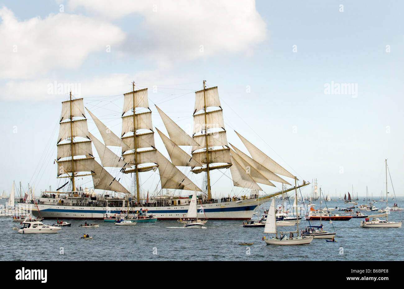 Russian Class A Tall Ship Mir surrounded by smaller ships during Funchal Tall Ships Regatta Falmouth Cornwall UK - Stock Image