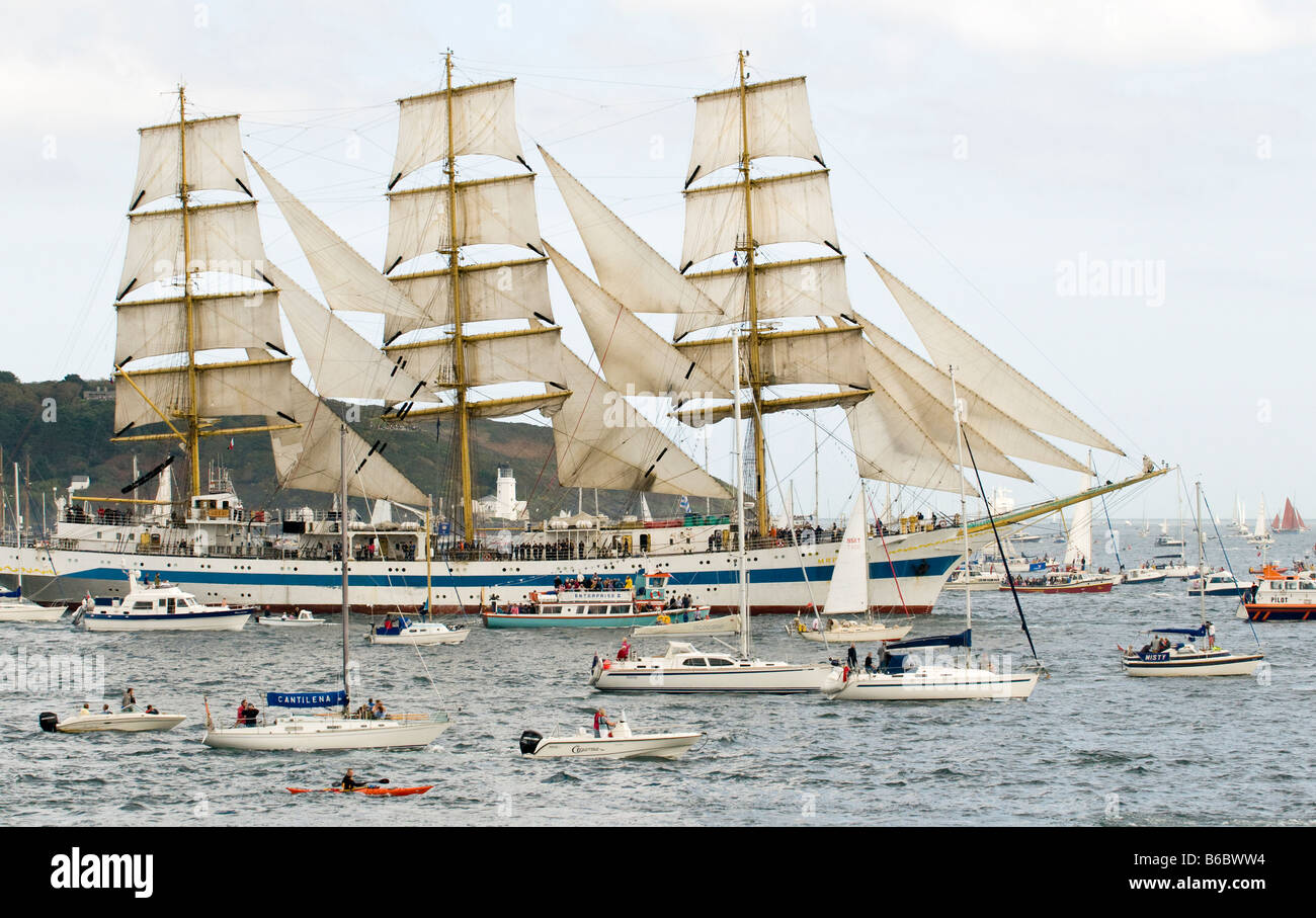 Russian Class A Tall Ship 'Mir' surrounded by smaller ships during Funchal Tall Ships Regatta, Falmouth, - Stock Image