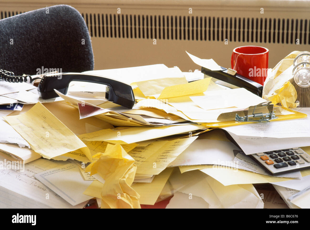 Messy Desk with Landline Phone and Rolodex, USA - Stock Image