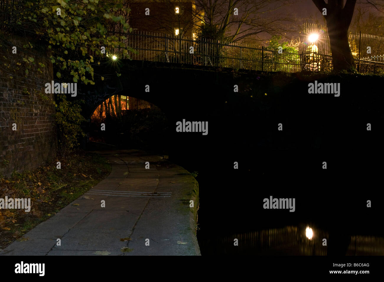 view under a bridge on regent's canal at night - Stock Image