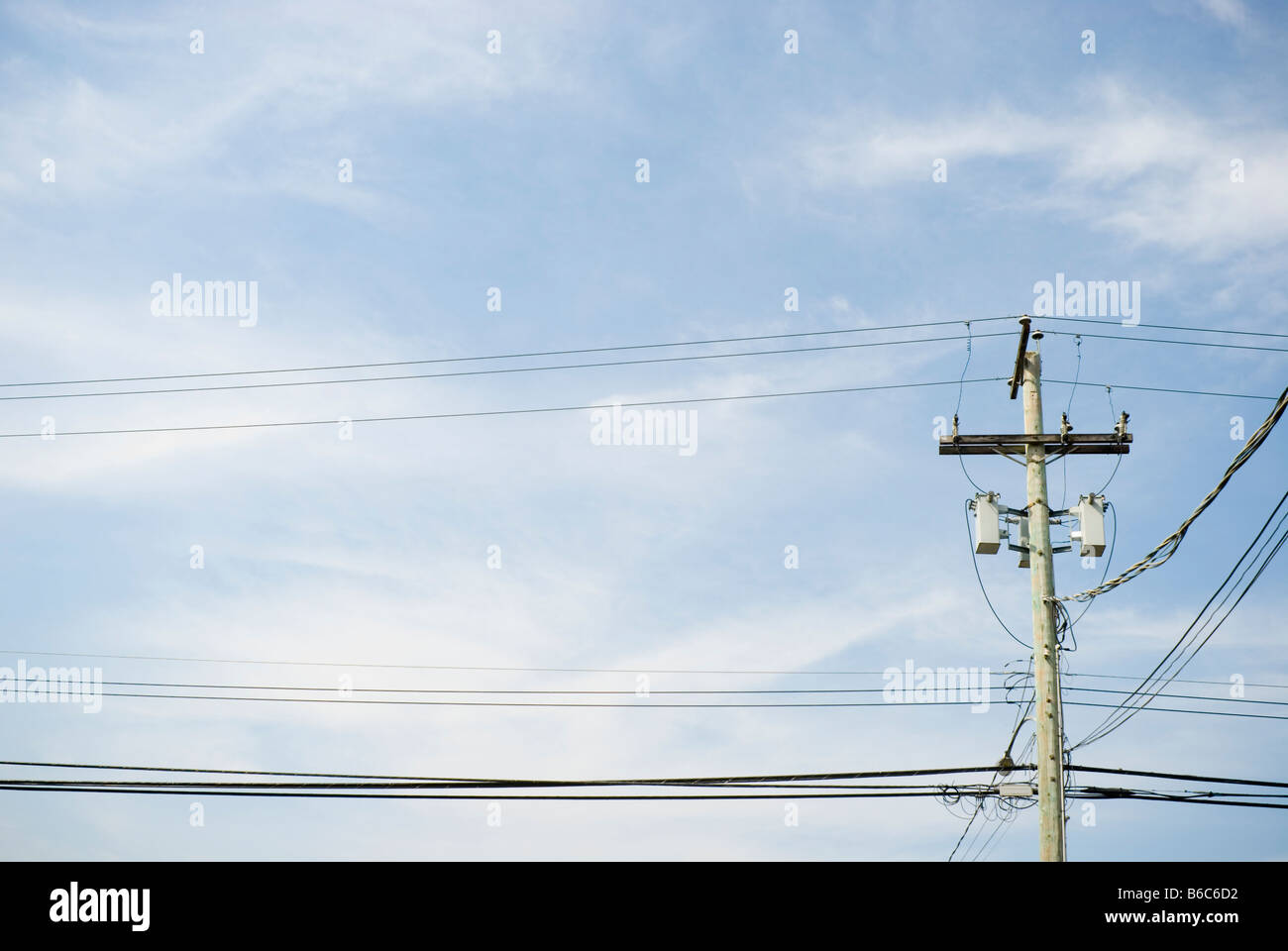 Suburban utility pole showing a complex of wiring and cables - Stock Image
