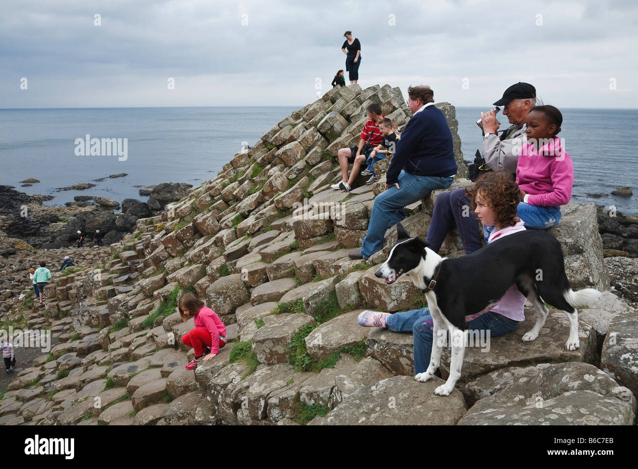 Tourists at the Giant's Causeway, County Antrim, Northern Ireland - Stock Image