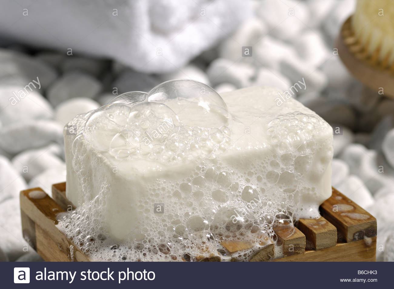 Close-up of soap bar with soap suds - Stock Image