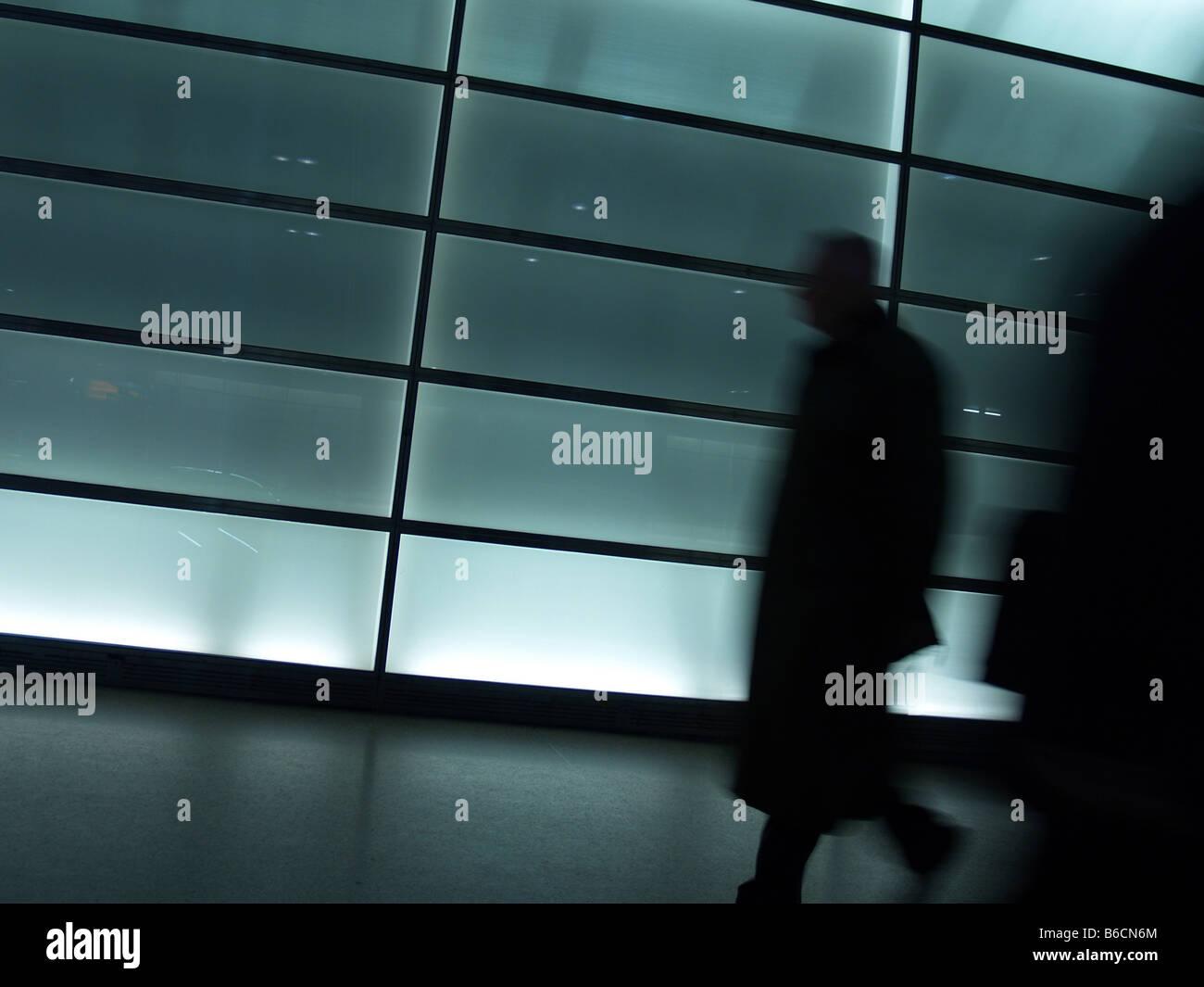 Silhouette of person walking in tunnel Potsdamer Platz Berlin Germany Stock Photo