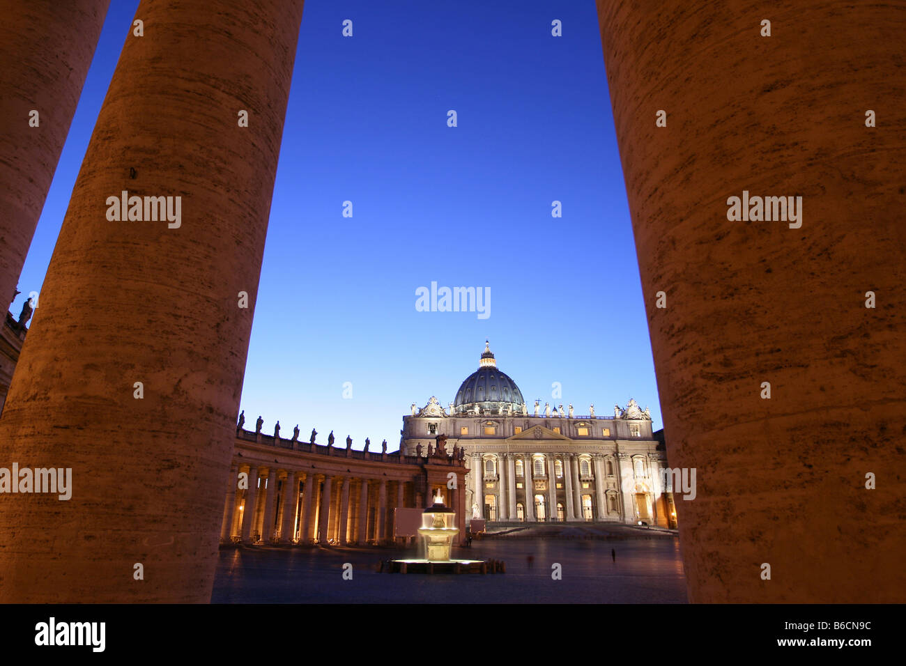 Cathedral viewed through columns at dusk, Rome, Italy - Stock Image