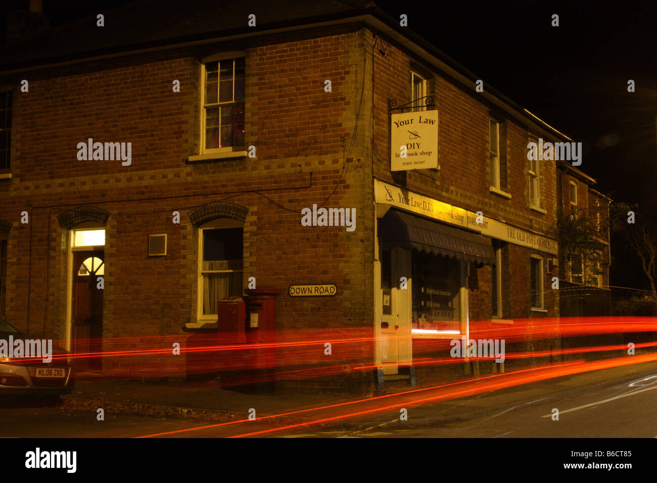 Corner Shop with Traffic Trails - Stock Image