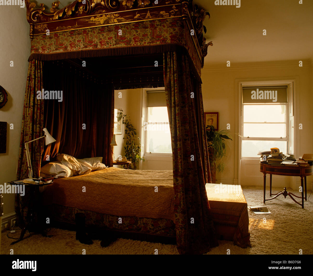Four poster bed in luxurious bedroom in grand English house. - Stock Image