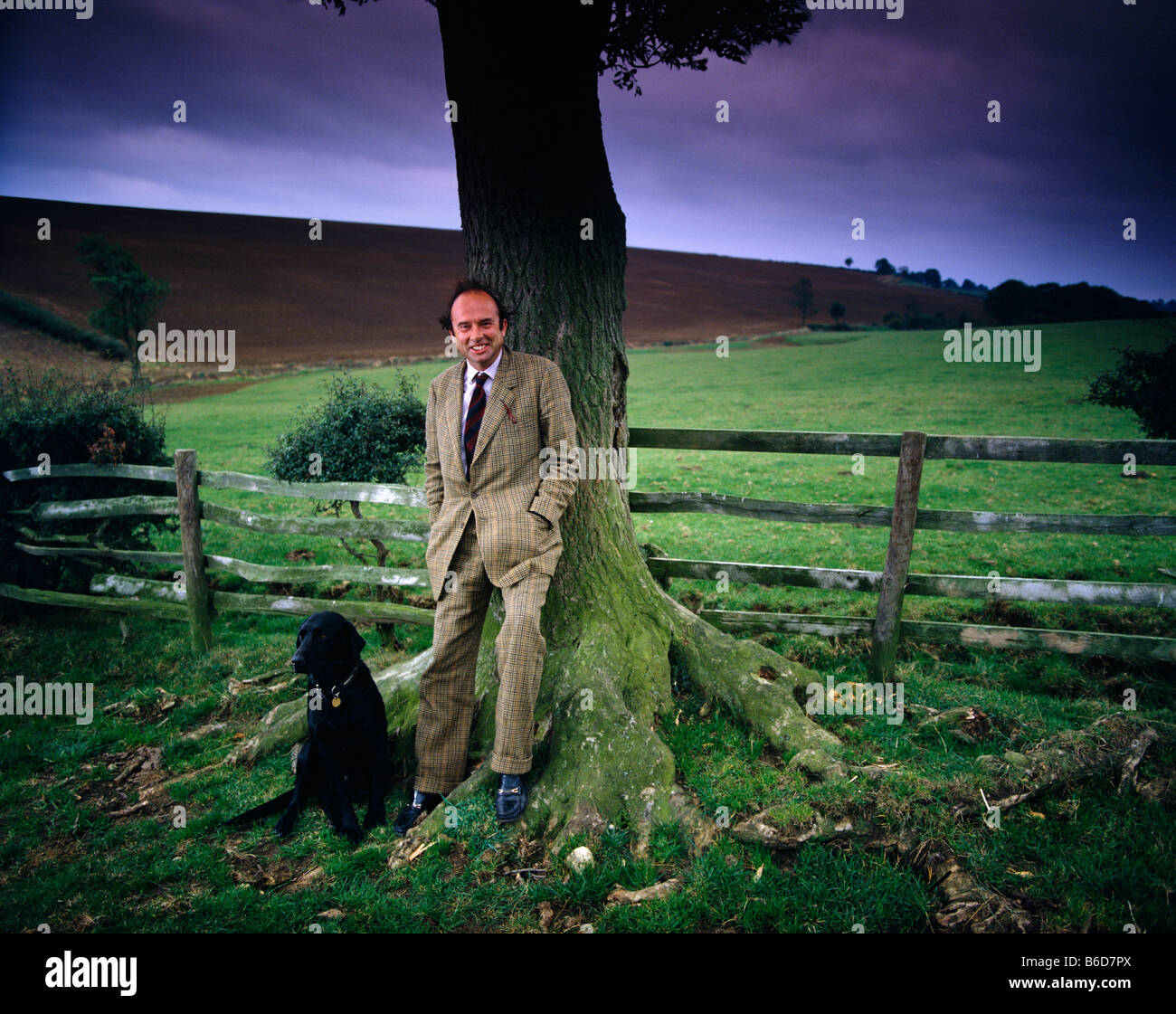 Lord Onlow in his grounds with his dog - Stock Image