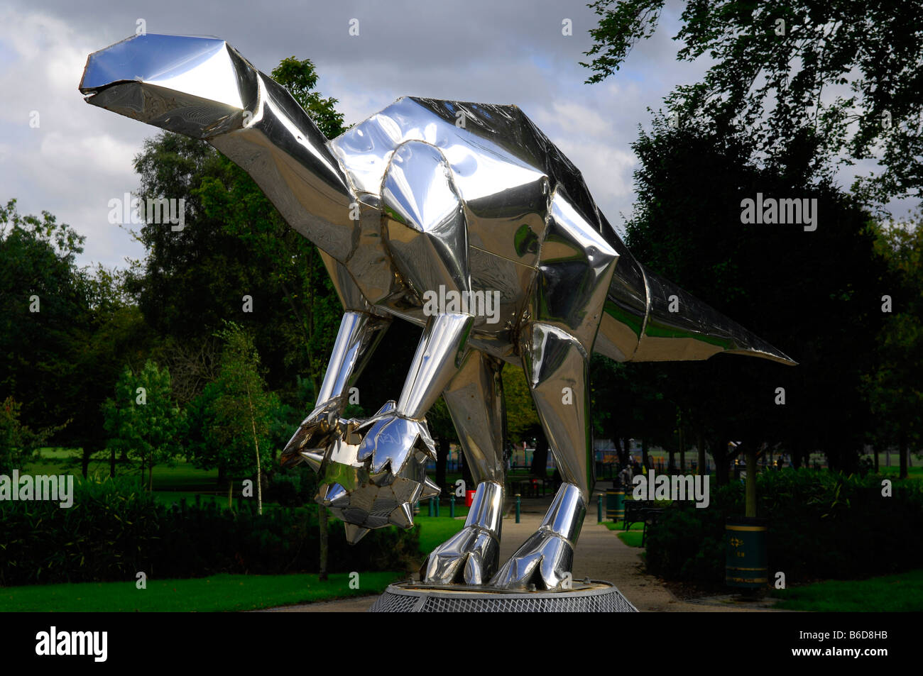 metallic shiny silver dinosaur sculpture - Stock Image