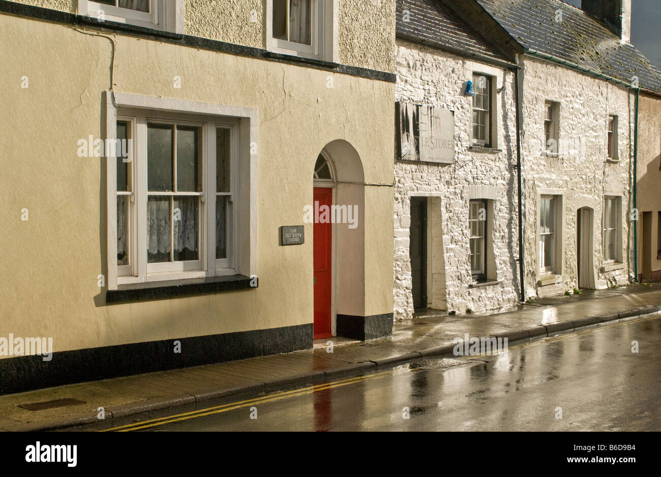 Laugharne Houses shining in the sun after a heavy downpour of rain - Stock Image