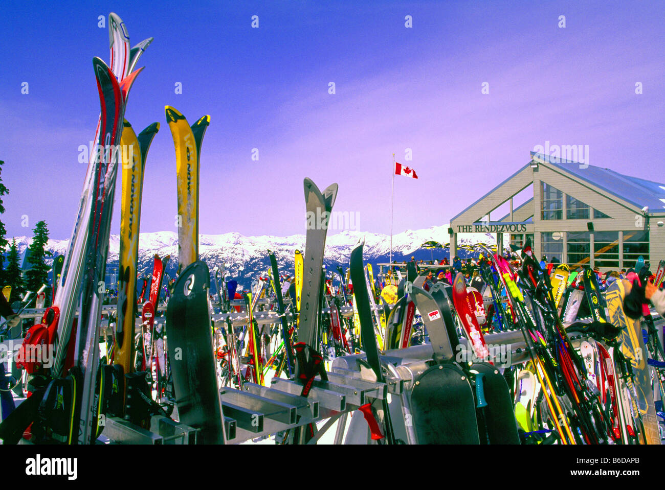 Skis and Snowboards resting against Ski Racks at The Rendezvous Day Lodge on Blackcomb Mountain Whistler British - Stock Image