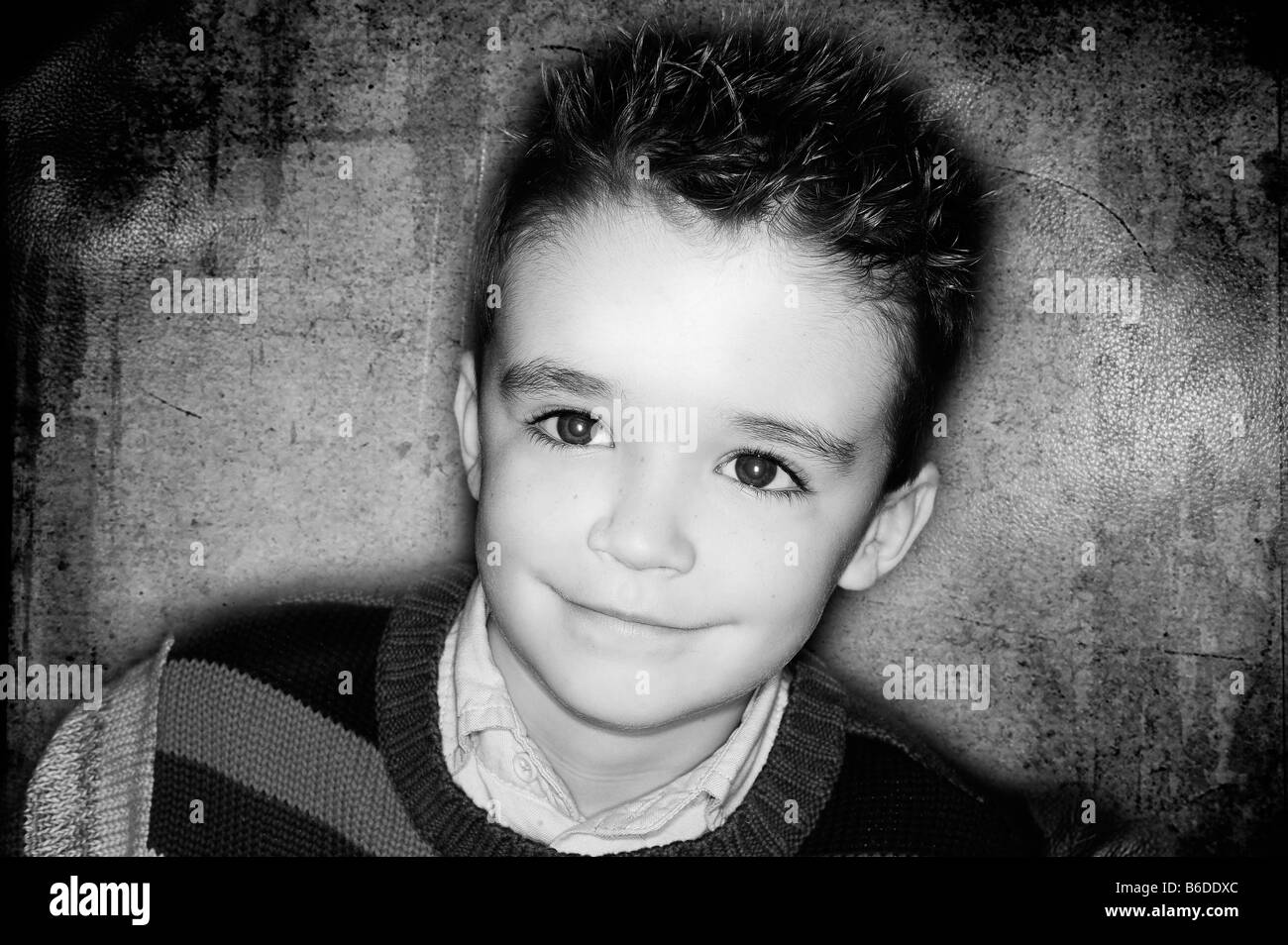 seven year old boy caucasian smiling spikey hair - Stock Image