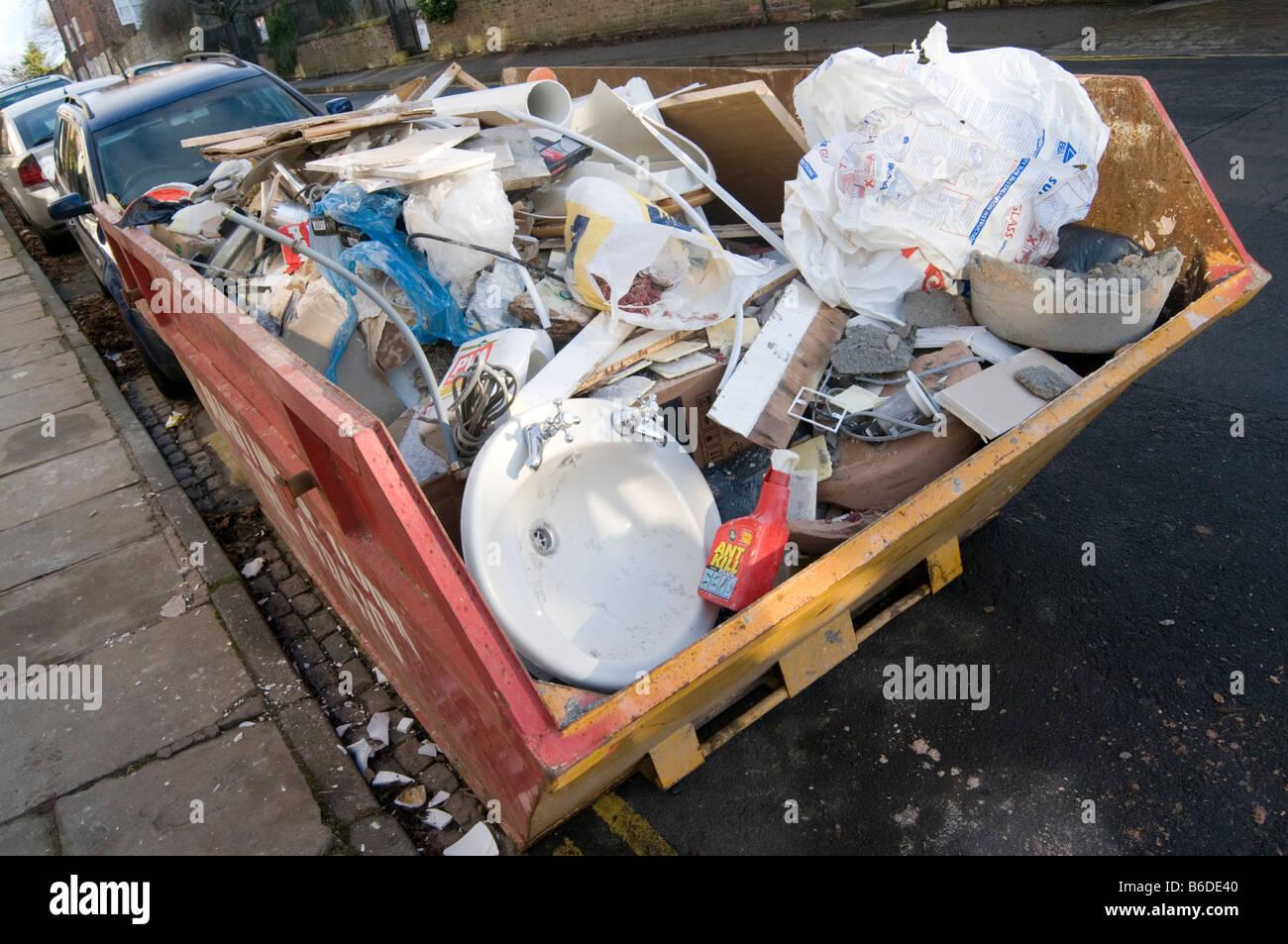 skip trash rubbish junk scrap throwaway dumpster can waste dispose disposal dump refuse disposal bin landfill uk - Stock Image