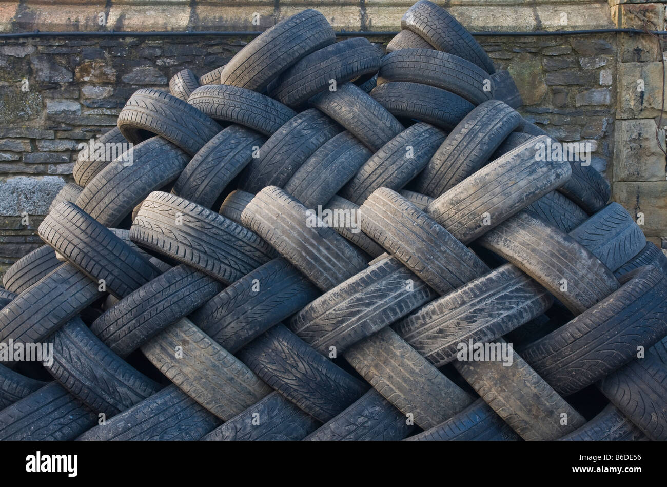 old tyres awaiting disposal or recycling - Stock Image