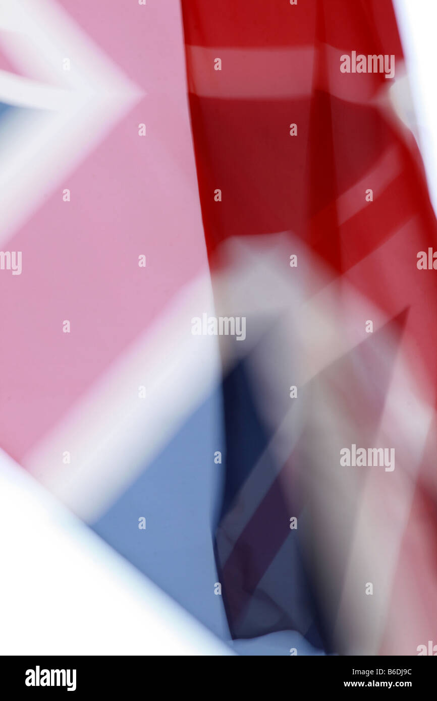 abstract union jack flag flying in wind in sun Stock Photo