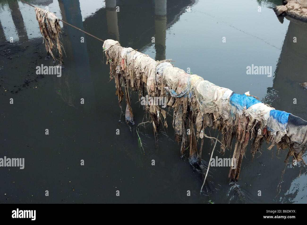 Black polluted waste water from factory discharge, Chongqing, China - Stock Image