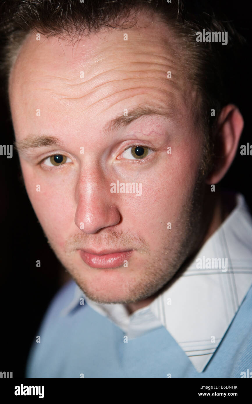 Portrait of an english man in his early twenties with a receding hairline - Stock Image
