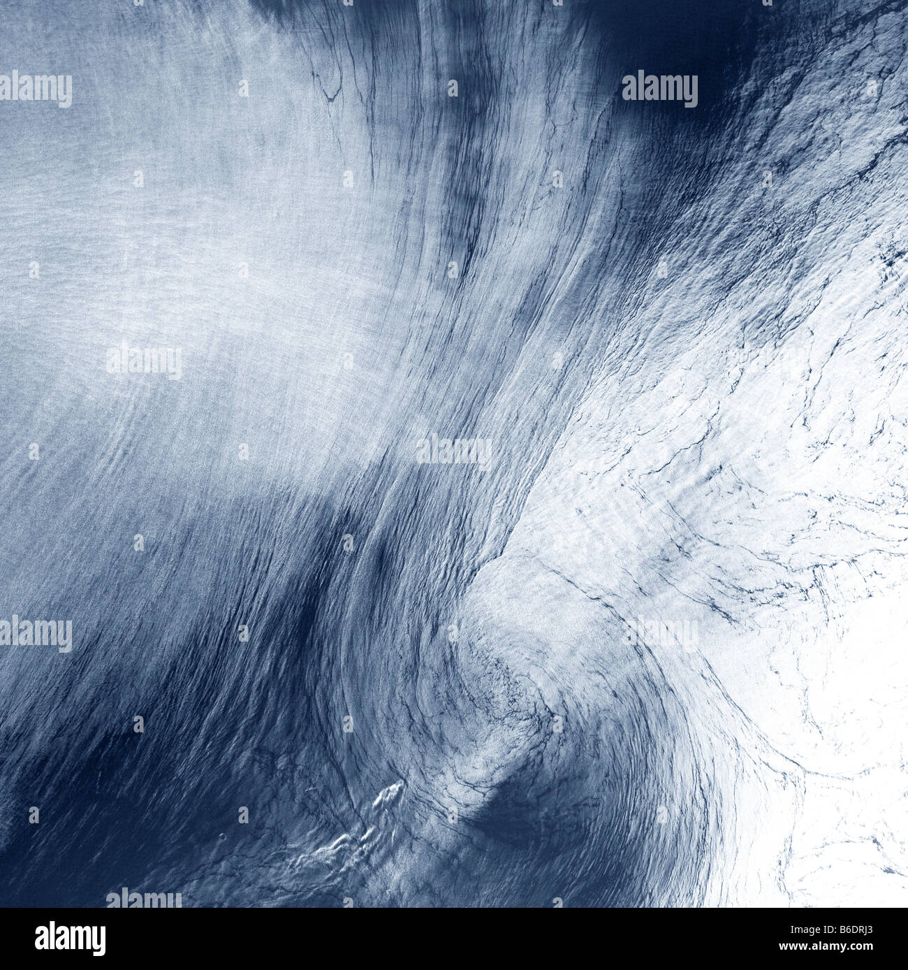 High-altitude clouds, satellite image. Theses wirling clouds are being shaped by high-altitude winds. - Stock Image