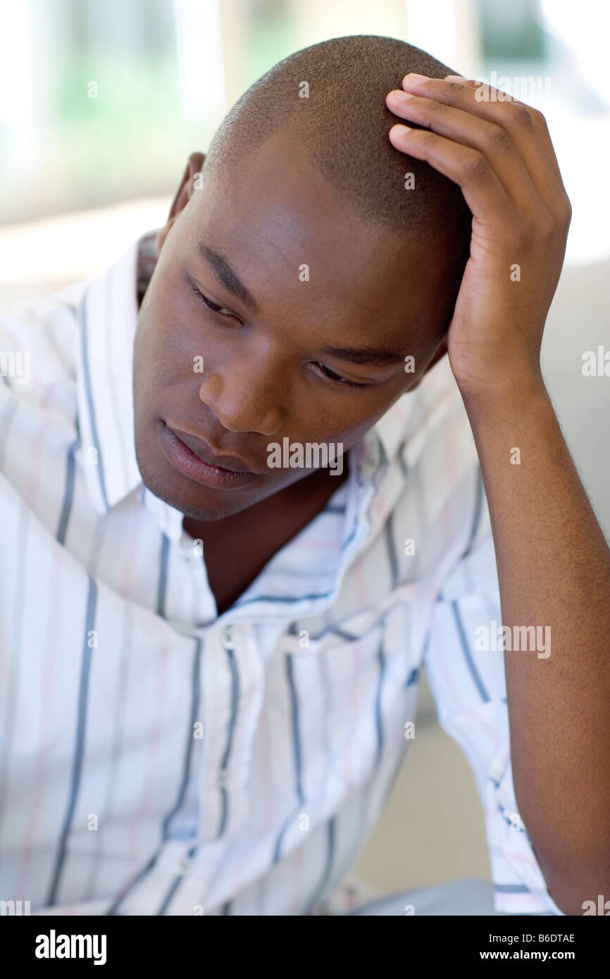 Depression. Unhappy man resting his head in his hand. - Stock Image