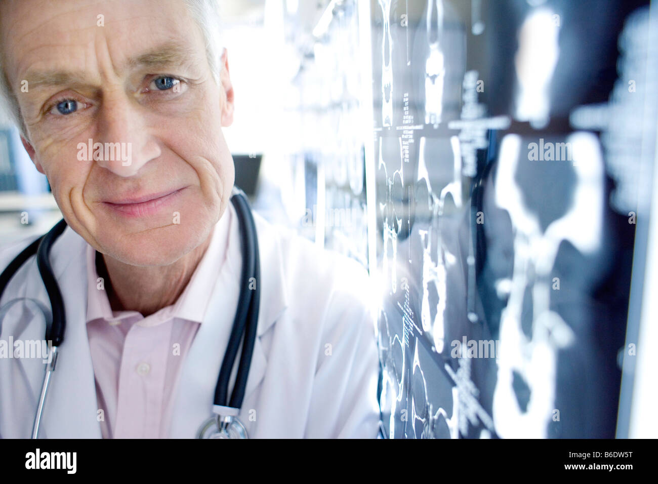 Radiologist beside CT scans. CT scanning is a diagnostic technique that uses X-rays to produce cross images. - Stock Image