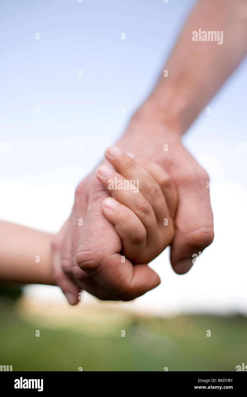 Father and son holding hands. - Stock Image