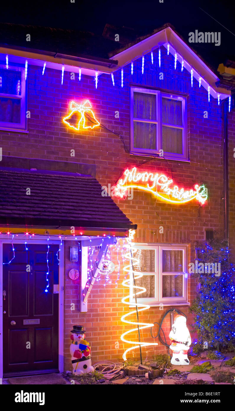 residential house at night lit up illuminated with christmas lights stock image