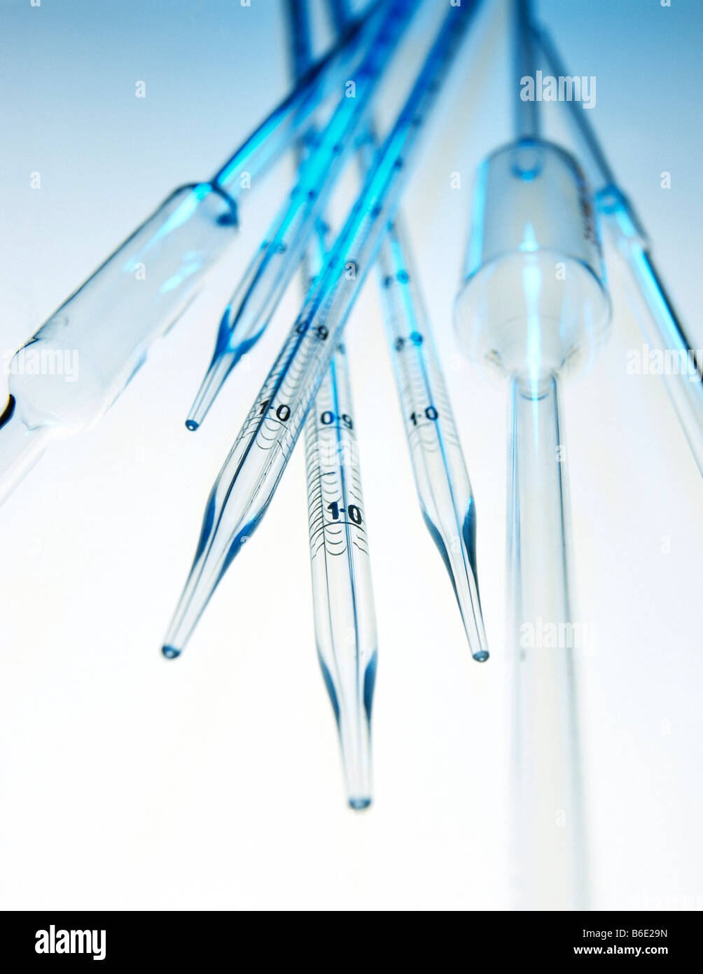 Glass pipettes. Standardised volume pipettes(with bulbs). These are used to measure exact volumes. - Stock Image