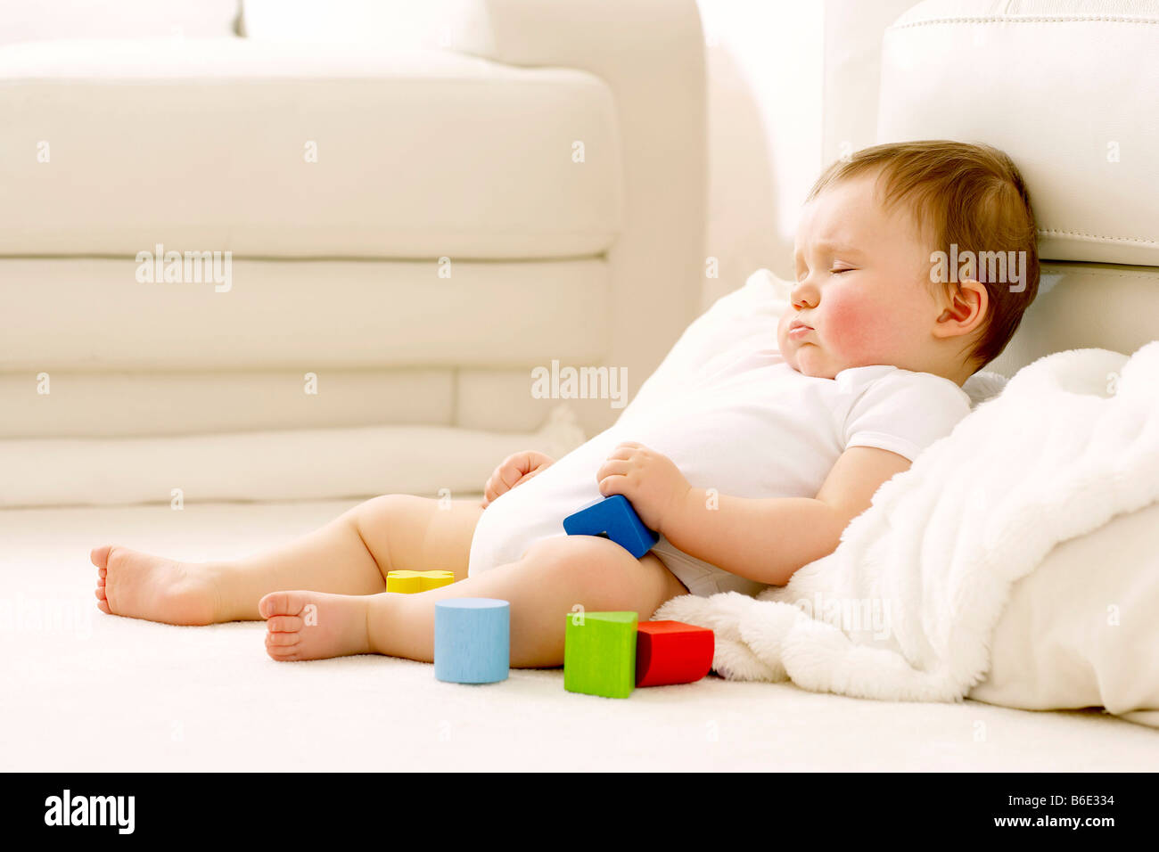 Baby boy (6-11 months) sleeping - Stock Image