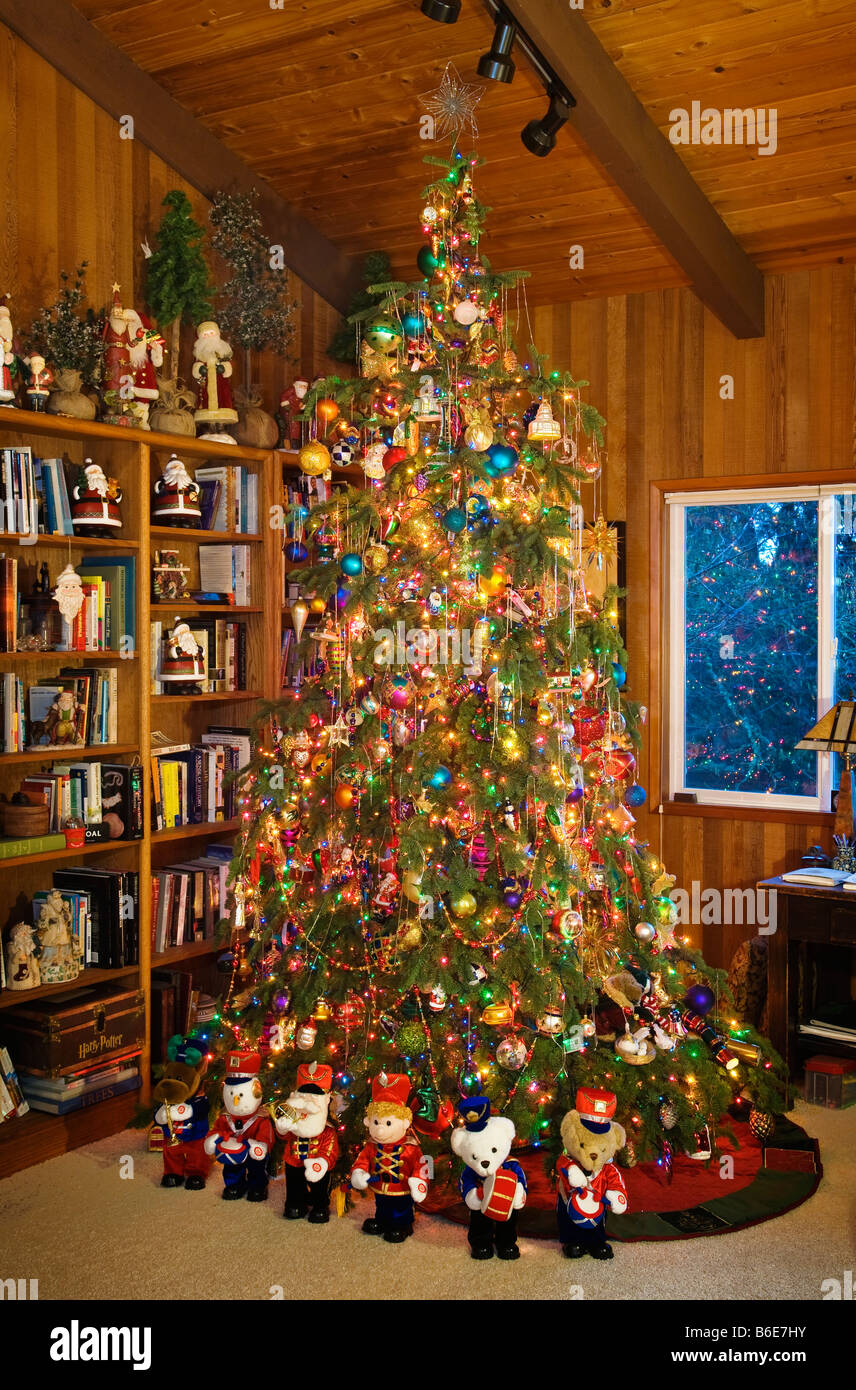 Heavily decorated Christmas tree in family room of upper middle class American home Stock Photo