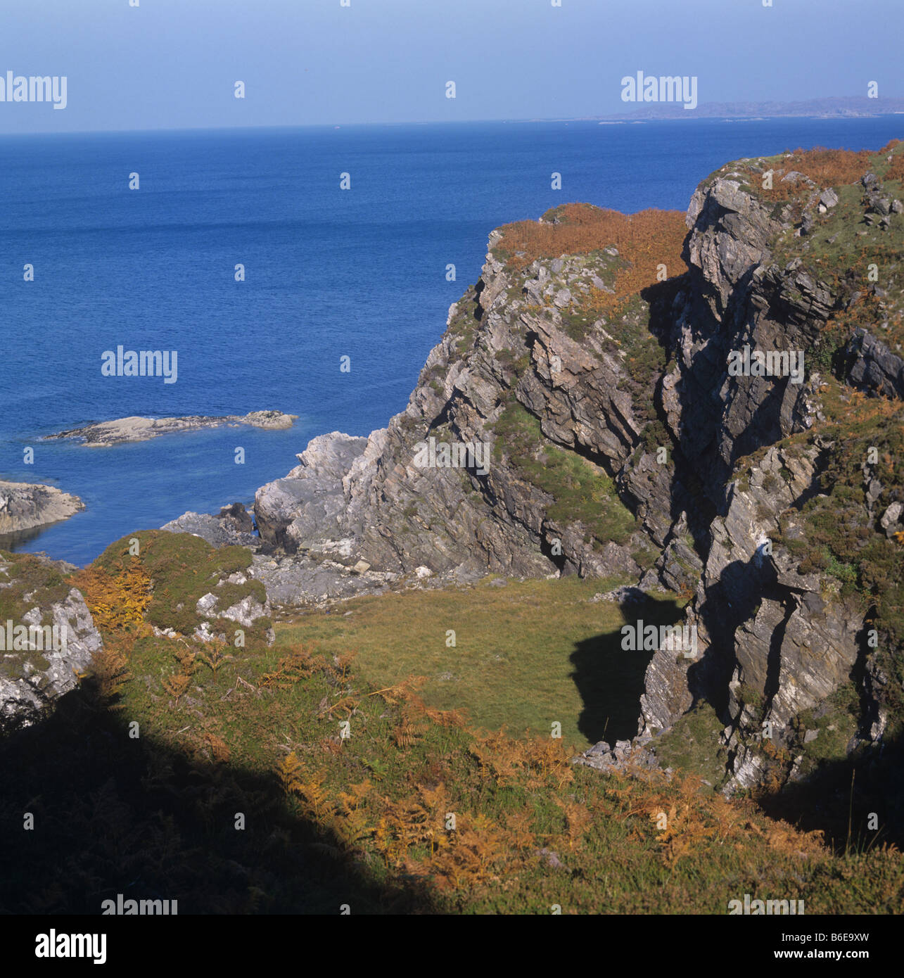 Autumn colours on the cliffs overlooking the Sound of Arisaig on the West Coast of Scotland - Stock Image