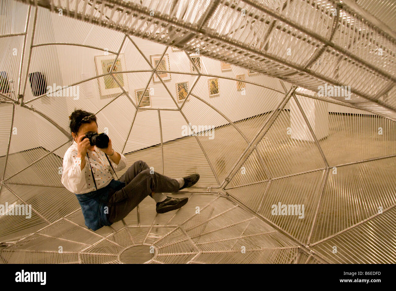 San Antonio's Museo Alameda with visitor photographing inside The Klein Bottle by Mexico City sculptor Pedro - Stock Image