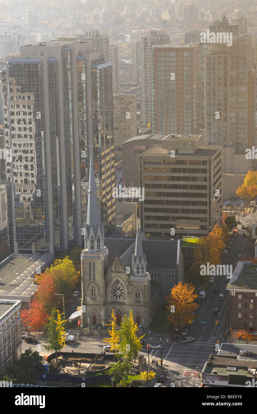 Aerial view of Holy Rosary Catholic church cathedral in haze surrounded by high-rise buildings in downtown Vancouver - Stock Image