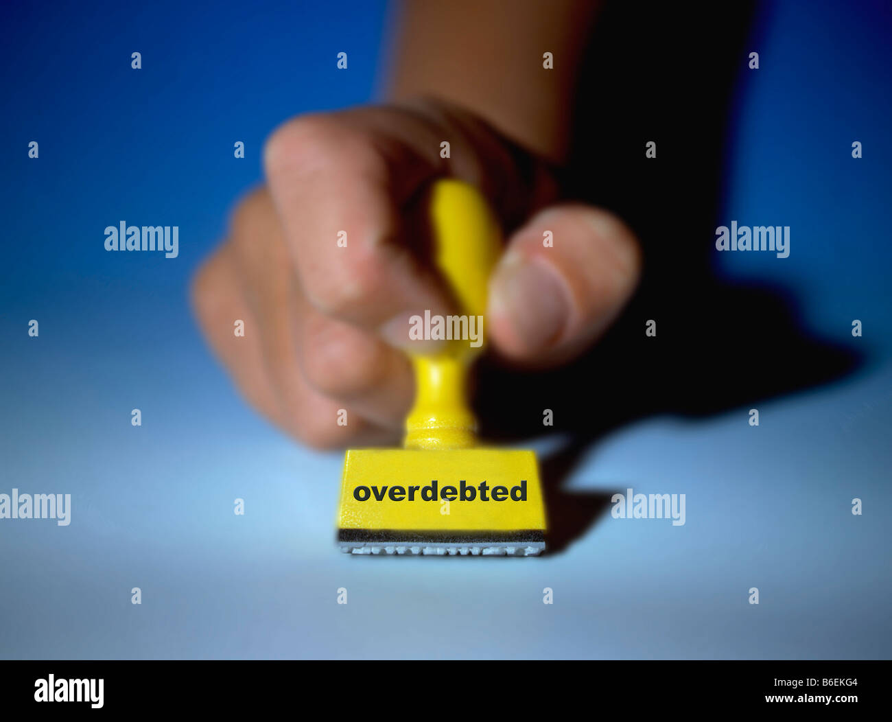 digital enhancement rubber stamp marked overdebted - Stock Image