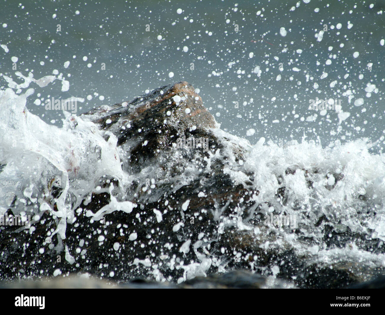 Water splash and rock - Stock Image