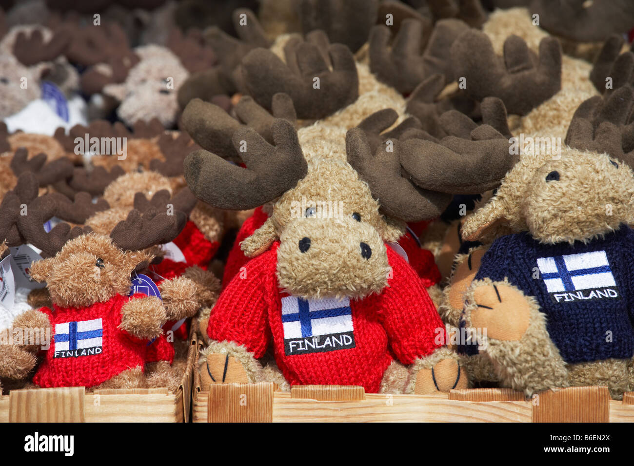 Fluffy Moose tourist gifts wearing Finnish flag sweaters on sale in the Market Square Helsinki Finland Stock Photo