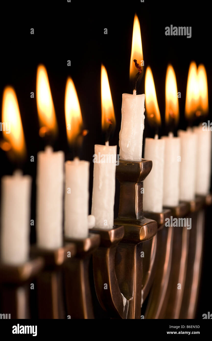 Beautiful lit hanukkah menorah on black - Stock Image