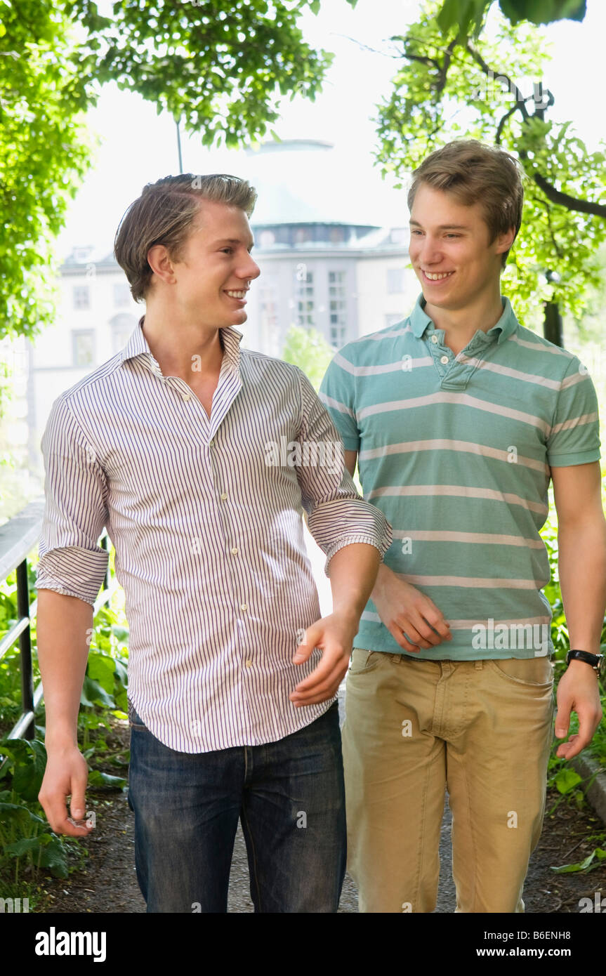 Two guys hanging out outdoors - Stock Image