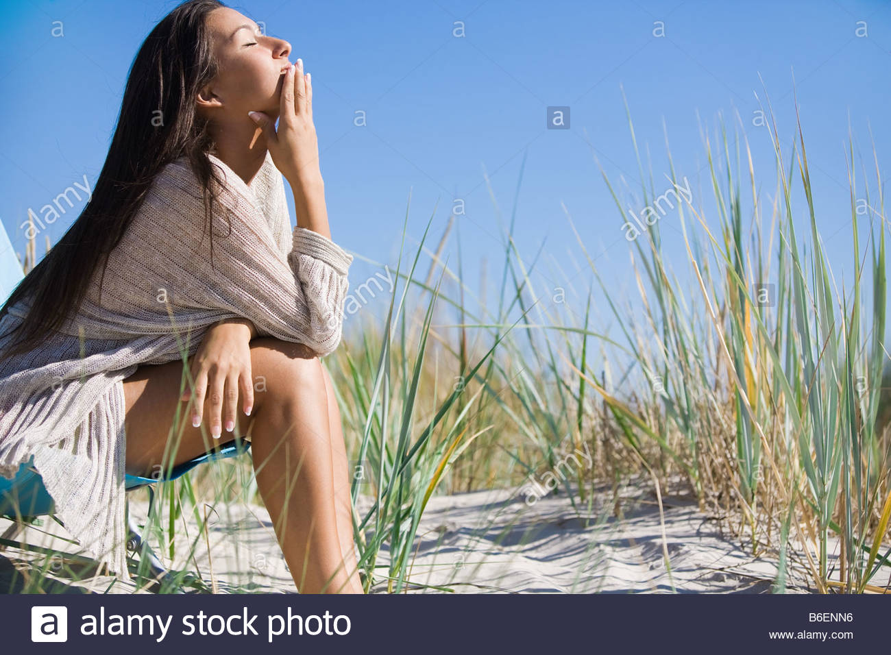 Woman alone o beach - Stock Image