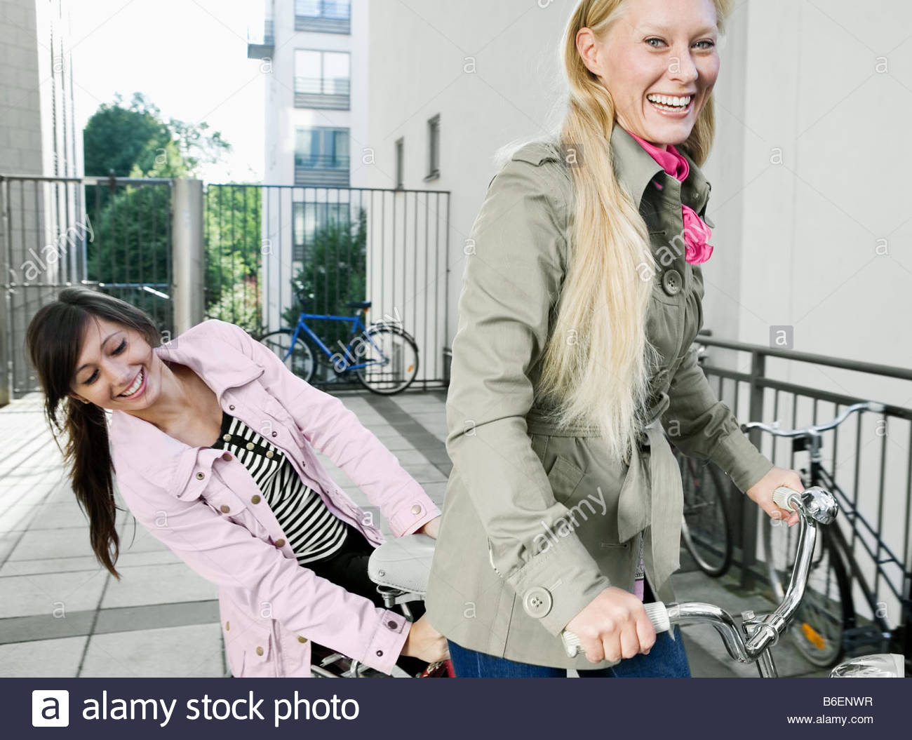 One girl giving another girl a ride - Stock Image